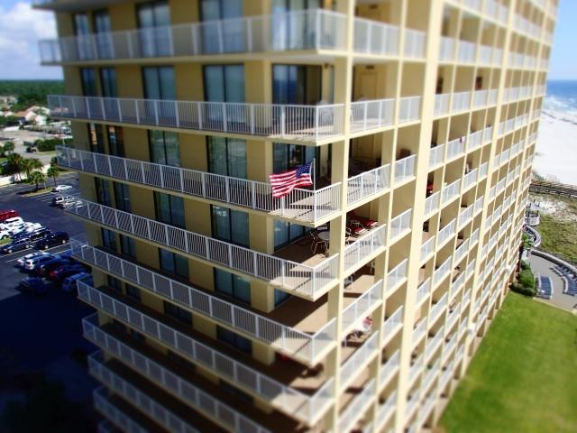 American flag on condo balcony, orange beach, alabama, the greener bench blog