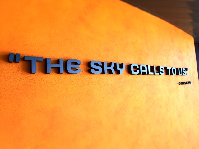the sky calls to us signage from carl sagan, space shuttle Atlantis exhibit building, kennedy space center, florida, the greener bench blog