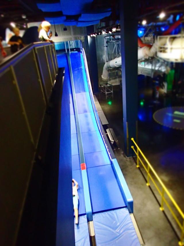 slides inside the Space Shuttle Atlantis exhibit building, Kennedy Space Center, Florida, the greener bench blog