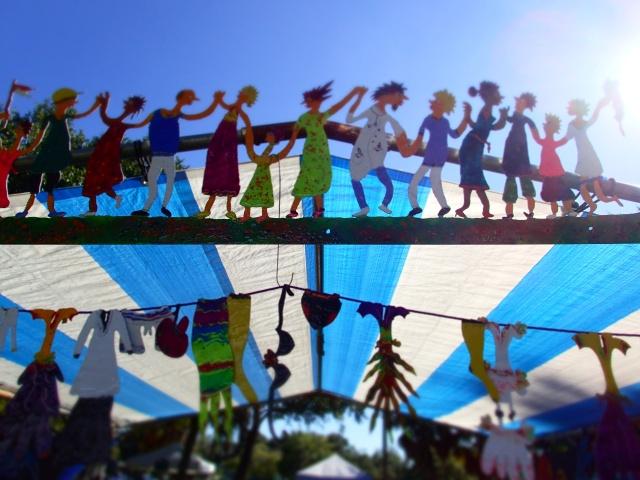 metal sculpture of people holding hands, circus mcgurkis, st Petersburg, florida, the greener bench blog